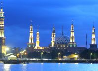 Big mosque in a riverside at dusk