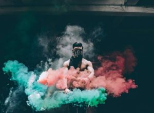 Man in colorful smoke.