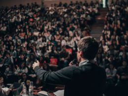 A man gives speech in front of thousand audiences